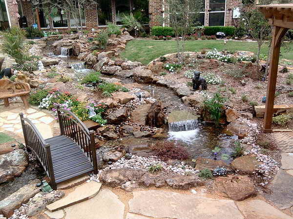 Backyard-Water-Features-With-Wood-Bridge